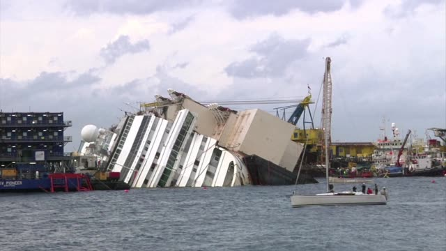 the italian island of giglio made final preparations sunday on the eve of an unprecedented attempt to raise the 114500ton costa concordia cruise ship... - record breaking stock videos & royalty-free footage