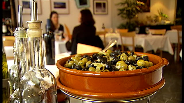 EXT The Italian Job restaurant on Fulham Road Plate of Bruschetta in Italian restaurant Azzurra Panichi interview SOT Andrea Scalesse interview SOT