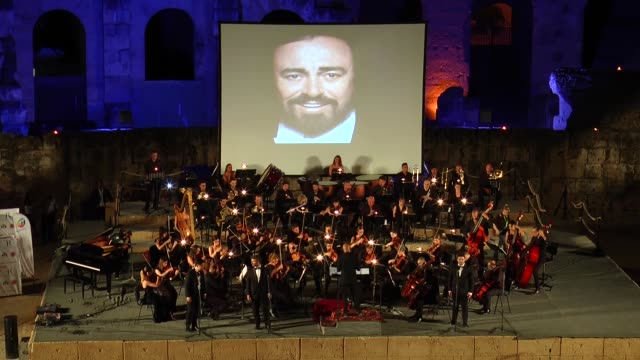 the italian opera orchestra perform at a concert in memory of luciano pavarotti during the 32nd edition of the el jem international symphonic music... - luciano pavarotti stock videos & royalty-free footage