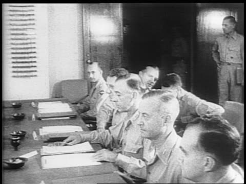 the japanese delegation is seated across from the american military representatives / montage of navy's third fleet at sea battleship uss missouri /... - uss missouri stock videos and b-roll footage