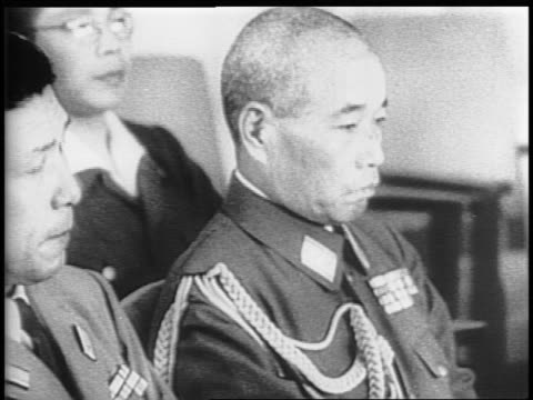 the japanese delegation take their seats across from the americans / montage of closeups on members of japanese delegation - japanese surrender stock videos and b-roll footage