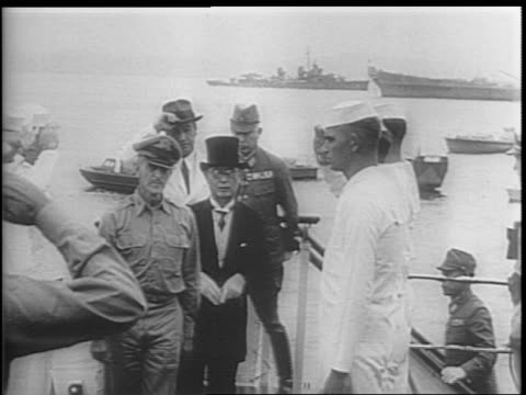 The Japanese envoy arrives including Foreign Minister Mamoru Shigemitsu in tuxedo and top hat General Yoshijiro Umezu leading the Imperial General...
