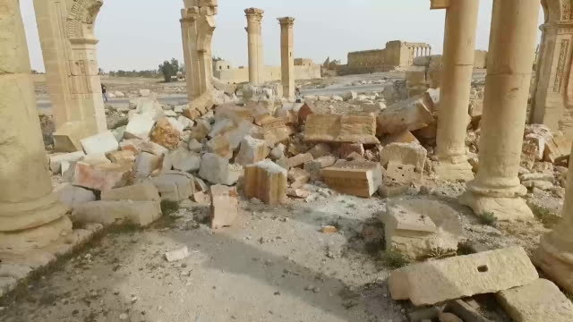 stockvideo's en b-roll-footage met the japanese media got its first onhand glimpse of the damage done to the ancient ruins in palmyra syria since the city was liberated from the... - isis