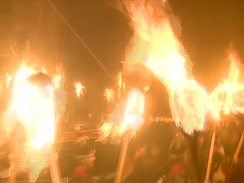 """the """"jarl squad"""", or costumed men, carry a replica viking galley for the up helly aa festival - flaming torch stock videos & royalty-free footage"""