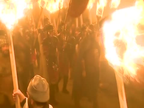 The Jarl Squad parade in the streets of Lerwick carrying flaming torches for the annual Up Helly Aa festival