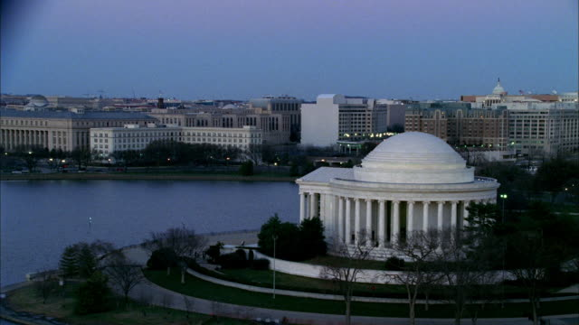 the jefferson memorial borders the potomac river tidal basin. - jefferson memorial stock videos & royalty-free footage