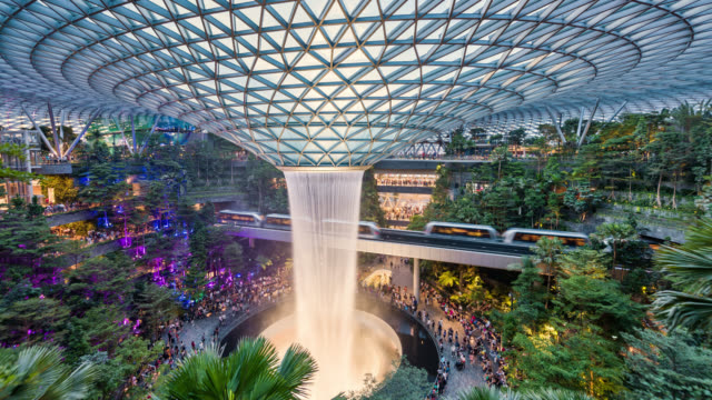 t/l the jewel, changi airport, entertainment and retail complex, with the world's tallest waterfall - hyper lapse stock videos & royalty-free footage