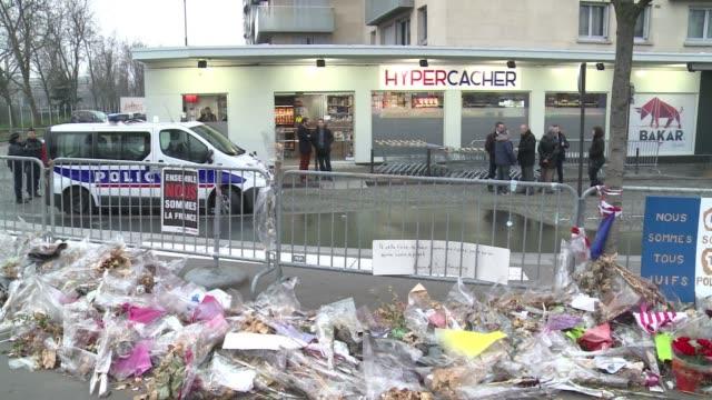 vídeos y material grabado en eventos de stock de the jewish supermarket in paris attacked by a jihadist gunman linked to the shootings at charlie hebdo magazine in january reopened on sunday - ceremonia de reapertura