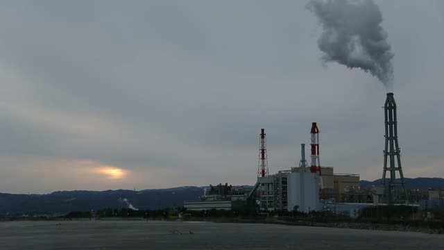 vidéos et rushes de the joban joint power co. nakoso coal-fired power station stands in iwaki city, fukushima prefecture, japan, on thursday, feb. 6 wide high angle... - lieux géographiques