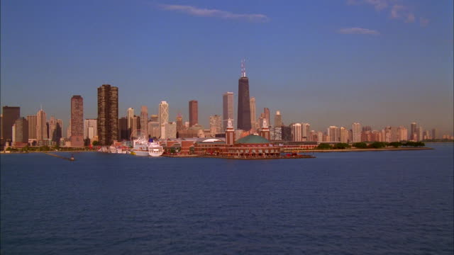 The John Hancock building towers over downtown Chicago and the Lake Michigan shorefront. Available in HD.