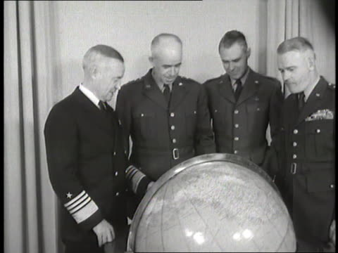 the joint chiefs of staff admiral forrest p sherman general omar n bradley general hoyt s vandenberg and general j lawton collins stand around a globe - joint chiefs of staff stock videos and b-roll footage