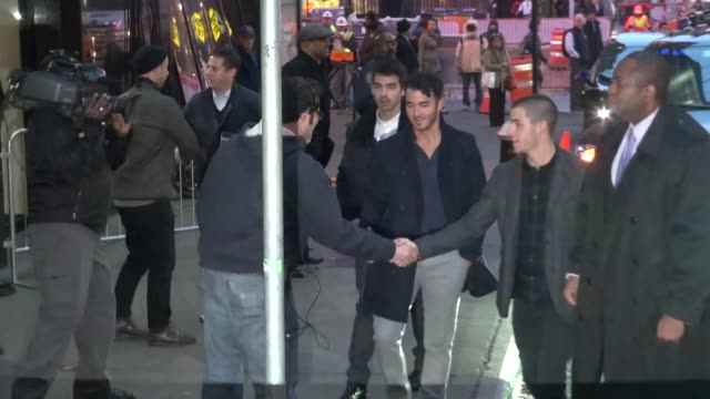 the jonas brothers arrive at good morning america meet with fans in celebrity sightings in new york 10/30/13 the jonas brothers arrive at good... - good morning america stock videos and b-roll footage