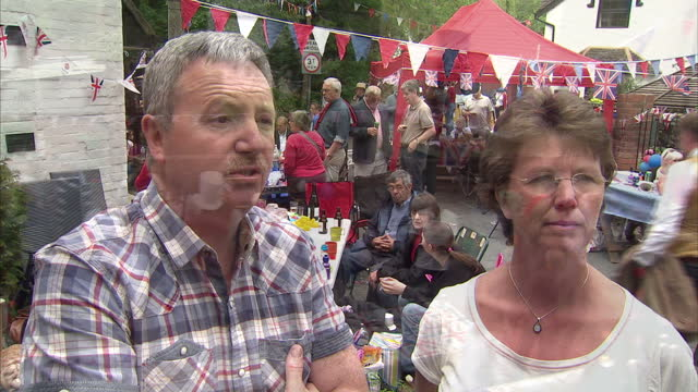 the jubilee spirit hasn't faded in worcestershire where locals are making the most of the long weekend by throwing their street party today robin... - street party stock videos and b-roll footage