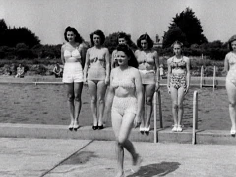 the judges pick a winner of the bathing beauty contest at the coronation holiday camp on hayling island. 1948. - holiday camp stock videos & royalty-free footage
