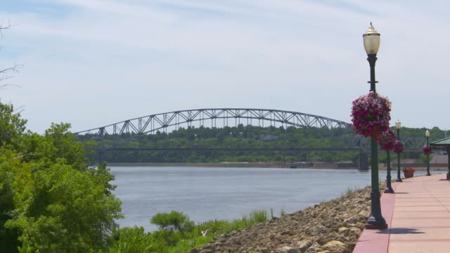 vídeos y material grabado en eventos de stock de the julien dubuque bridge from the port of dubuque in dubuque, iowa on july 25, 2018. - music or celebrities or fashion or film industry or film premiere or youth culture or novelty item or vacations