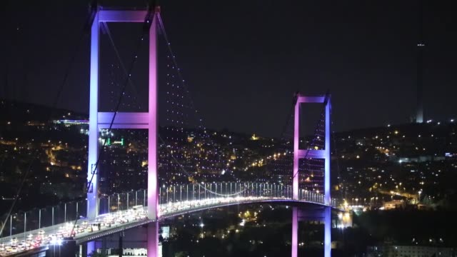 the july 15 martyrs' bridge is illuminated in the colours of the national flags of turkey russia germany and france following the fournation summit... - july 15 martyrs' bridge stock videos & royalty-free footage