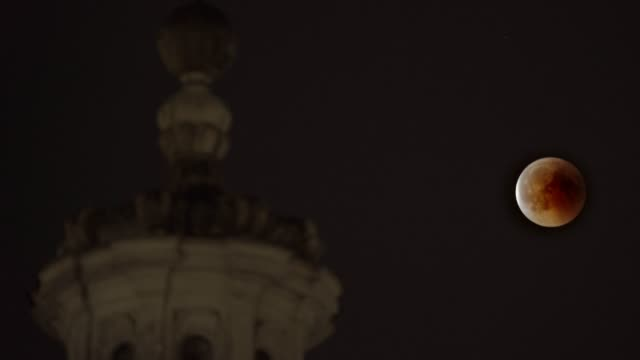 the july 2018 lunar eclipse is seen over the roman forum and the church of san giuseppe dei falegnami in rome, italy. - astronomy stock videos & royalty-free footage