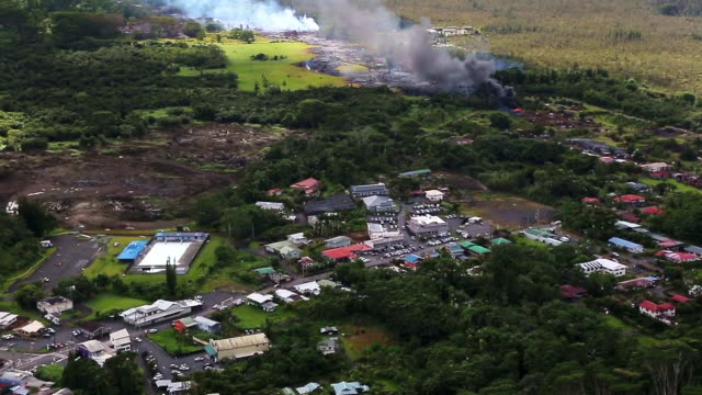 the june 27th lava flow from the kilauea volcano moves along he ground october 28, 2014 in pahoa, hawaii. observatory conducted ground and air... - big island insel hawaii stock-videos und b-roll-filmmaterial