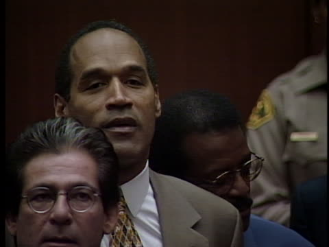 the jury gives verdict and proclaims oj simpson not guilty for the murders of nicole brown simpson and ronald goldman - ジョニー コクラン点の映像素材/bロール