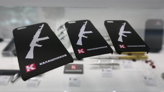 The Kalashnikov logo sits on items of clothing on display inside the Kalashnikov Concern JSC store at Sheremetyevo airport in Moscow Russia on...