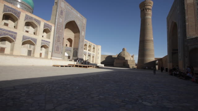 the kalyan minaret, kalyan mosque and mir-i arab madrassah at sunset, bukhara, uzbekistan - bukhara stock videos and b-roll footage