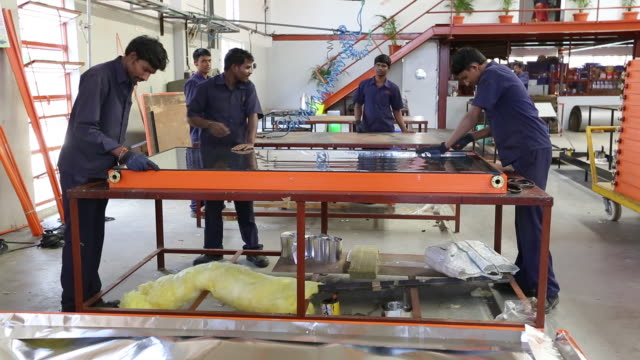 the kamal factory in bangalore, karnataka, india that manufactures solar thermal panels for heating water. - bangalore stock videos and b-roll footage