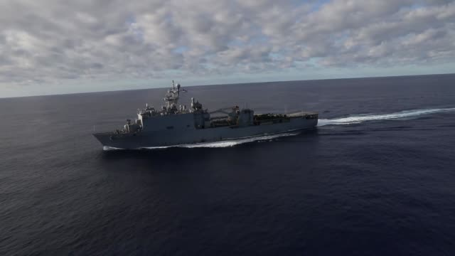 the kearsarge amphibious ready group uss kearsarge uss arlington and uss fort mchenry transit the atlantic ocean - warship stock videos & royalty-free footage