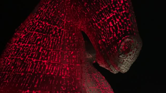 the kelpies are lit red in a visual show of support for the scottish poppy appeal ahead of remembrance sunday in falkirk, central scotland. - remembrance sunday stock videos & royalty-free footage