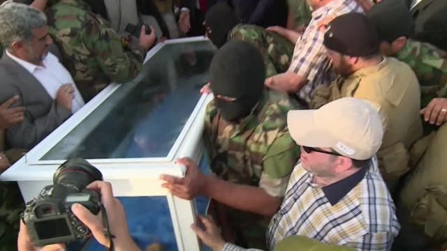 the ketaeb hezbollah paramilitary group handed over the body of a man suspected of being saddam hussein's long fugitive deputy izzat ibrahim al duri... - saddam hussein stock videos & royalty-free footage