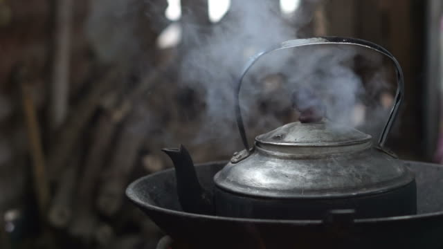 the kettle on the stove, close up. - kettle stock videos & royalty-free footage
