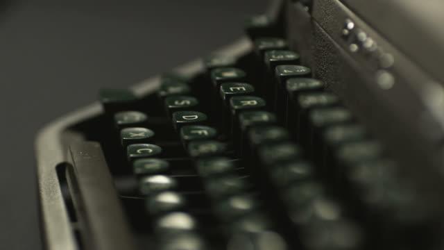 the keyboard of an old-fashioned typewriter - typewriter keyboard stock videos & royalty-free footage