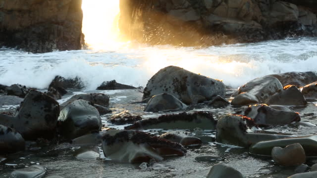 The Keystone Arch in the Big Sur area of the California coast with the sun shining through.