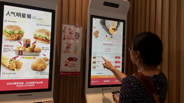 the kfc restaurant is a self order restaurant in which customers order food only from the machine or their smart phone kfc invest more on self... - self service stock videos & royalty-free footage