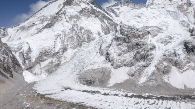 stockvideo's en b-roll-footage met the khumbu glacier flowing off mt. everest with base camp beneath - mount everest