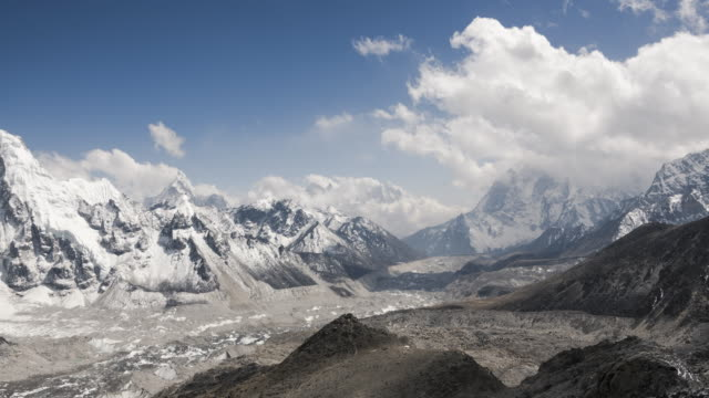 the khumbu glacier in nepal flows from everest down the valley and is the worlds highest glacier - khumbu stock videos and b-roll footage