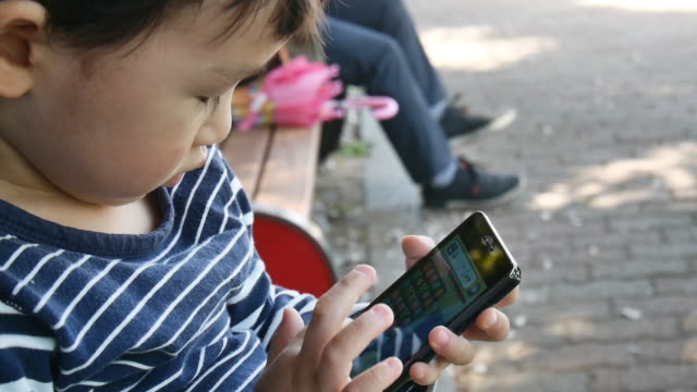 The Kid who touching smart phone