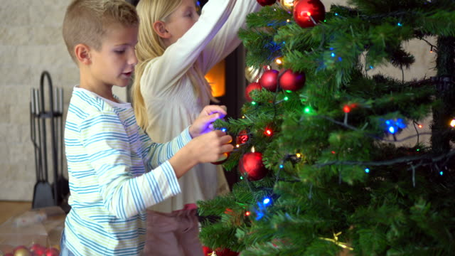 the kids love to decorate the christmas tree - distillery still stock videos & royalty-free footage