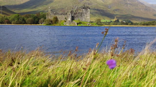 the kilchurn castle in scotland with beautiful colors. - lakeshore stock videos & royalty-free footage