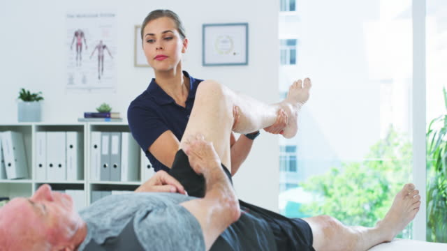 the kind of care you can depend - physiotherapy stock videos & royalty-free footage