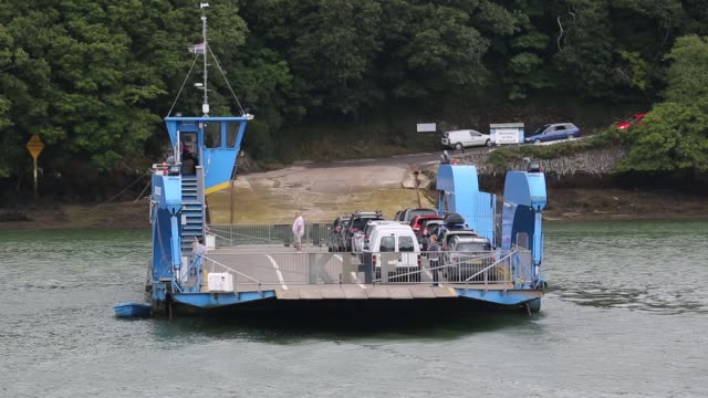 the king harry ferry crosses the river fal on august 20, 2015. the ferry connects falmouth with the roseland peninsular, cornwall, united kingdom. - patio stock videos & royalty-free footage