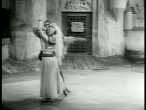 vidéos et rushes de the king takes the minstrel's hand places it w/ the princess' hand blessing the union the princess the minstrel dance pas de deux in courtyard - 1952