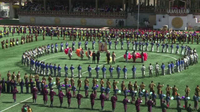 the kingdom of bhutan celebrates the 34th birthday of its king with fanfare at the country's national stadium clean bhutan celebrates the 34th... - thimphu stock videos & royalty-free footage