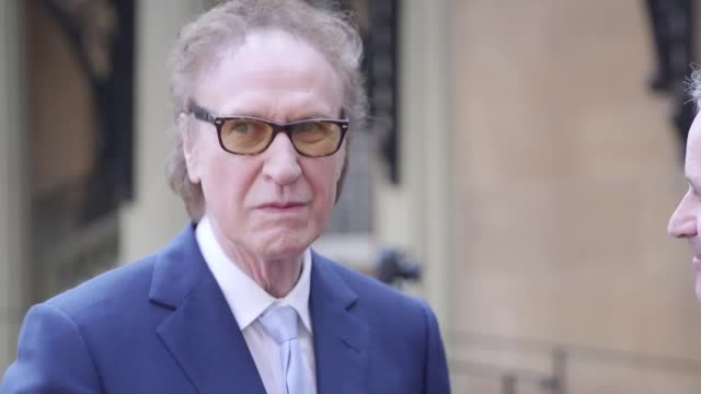 the kinks member ray davies and photographic journalist legened don mccullen get knighted by prince charles in an investiture ceremony at buckingham... - the kinks stock videos & royalty-free footage