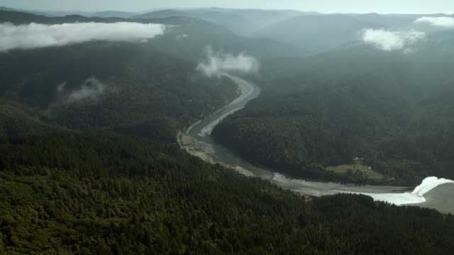 The Klamath River winds through the thickly forested Klamath Mountains, aerial view.
