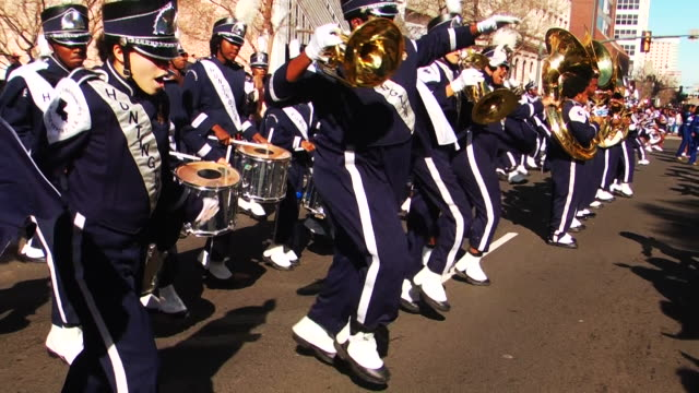 the 'krewe of harambee mardi gras parade' is held annually on martin luther king jr day / spectators attend the celebration in downtown shreveport to... - marching band stock videos & royalty-free footage