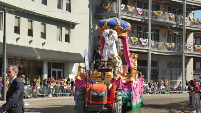 The Krewe of Okeanos King James A Maxwell travels on a float around Lee Circle during Mardi Gras in New Orleans