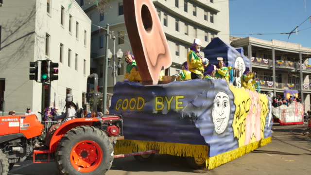 the krewe of okeanos ouija board parade float passes lee circle on st charles avenue in new orleans during mardi gras the theme of the parade was... - gras stock videos and b-roll footage