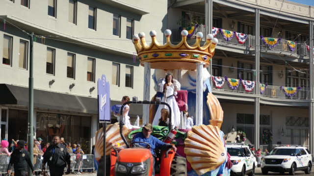 The Krewe of Okeanos Queen passes Lee Circle on St Charles Avenue in New Orleans during a Mardi Gras parade The theme of the parade was Okeanos Puts...