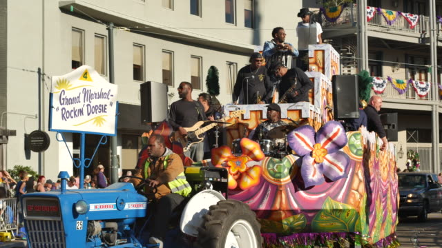 The Krewe of Thoth Grand Marshal 'Rockin' Dopsie' float passes Lee Circle on St Charles Avenue in New Orleans during Mardi Gras