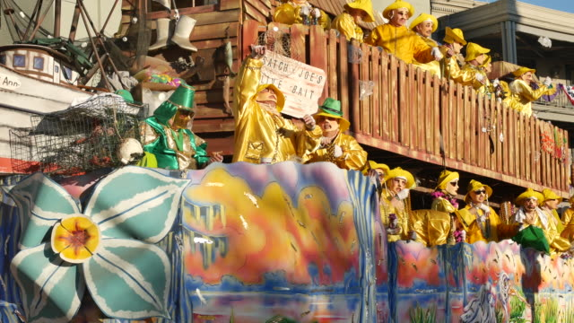 The Krewe of Thoth Things with Wings Wing Nets themed parade Mardi Gras float passes Lee Circle as beads are thrown into the crowd